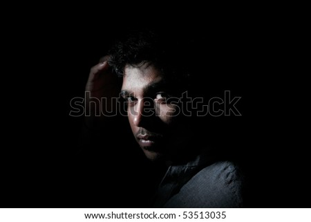 Abstract portrait of an Indian man - stock photo