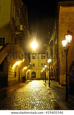 Abstract poster cobble stone street at night with shining street lamps and romantic couples - stock photo