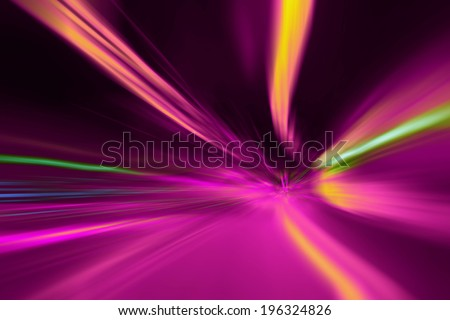 Abstract purple tunnel lights acceleration speed motion blur. Vintage filter effect used. Motion blur visualizies the speed and dynamics. - stock photo