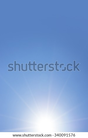 Abstract real sunbeam on the lower side of blue sky background.