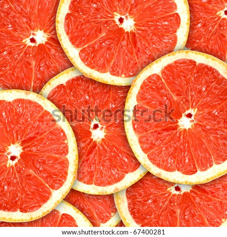 Abstract red background with citrus-fruit of grapefruit slices. Close-up. Studio photography. - stock photo