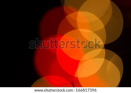 Abstract red defocused christmas lights as background.