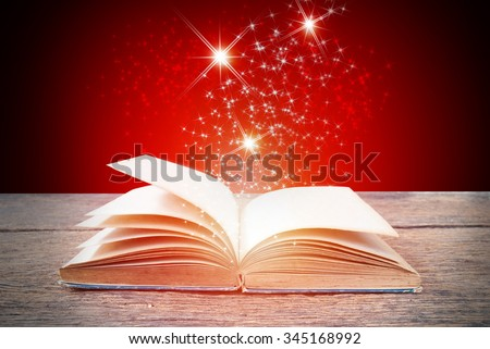 Abstract red magic book on wooden background - stock photo