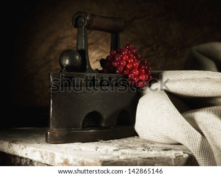 Abstract retro still life with vintage iron and hessian textile - stock photo