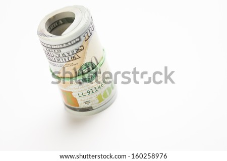 Abstract Roll of Newly Designed U.S. One Hundred Dollar Bills. - stock photo
