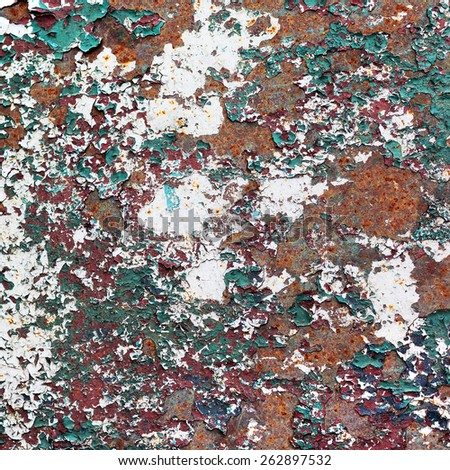 Abstract rusty metal surface with cracked paint green and burgundy. Textured background for your concept or project. Great background or texture. - stock photo