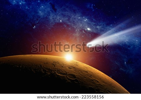 Abstract scientific background - comet approaching planet Mars. Elements of this image furnished by NASA - stock photo