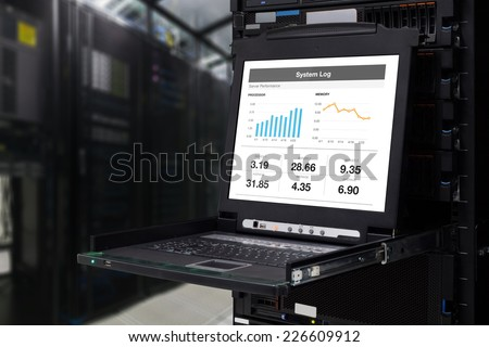 Abstract server computer KVM display in the modern interior of data center.  - stock photo