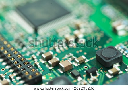 Abstract shallow dof closeup of HDD controller PCB showing various components over PCB - stock photo