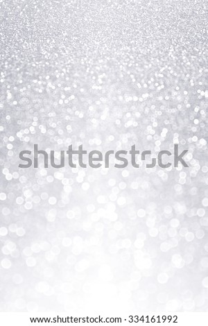 Abstract shiny elegant silver and white glitter sparkle background party invite - stock photo