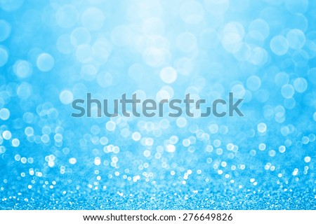 Abstract shiny light blue glitter sparkle confetti party background - stock photo