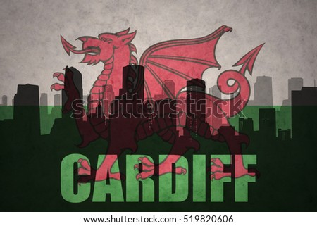 abstract silhouette of the city with text Cardiff at the vintage wales flag background