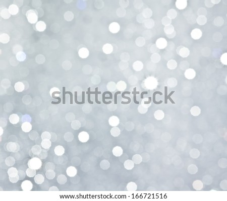 Abstract silver circular bokeh background of christmas light - stock photo