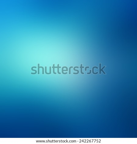 abstract sky blue blurred background colors in soft blended design with white spotlight  - stock photo