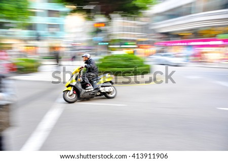 Abstract slow motion biker riding sport motorbike. Side view. Blur movement. Speed concept/Sport motorbike riding - stock photo