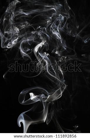 Abstract smoke isolated on black - stock photo
