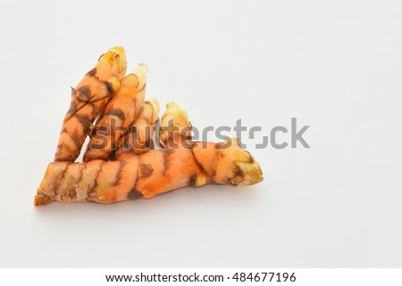 Abstract soft focus of turmeric tuber with the white copy space background.