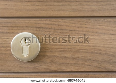 abstract space silver keyway on wood door close-up - can use to display or montage on product