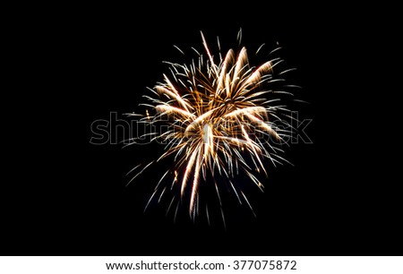 Abstract Sparkling Fireworks Light up The Sky with Dazzling Display with Copyspace to input Text - stock photo