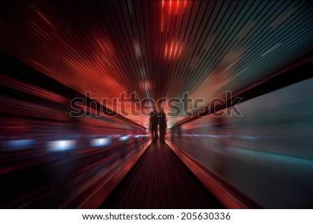 Abstract speed motion in red and green lights tunnel, fast moving toward the light. - stock photo