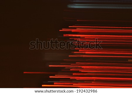 Abstract speedy drive on black asphalt road at night background.