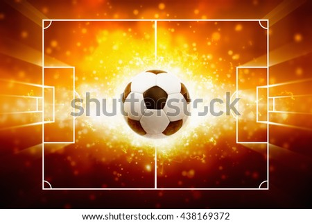 Abstract sports background - burning soccer ball against flash of light looks like explosion - stock photo