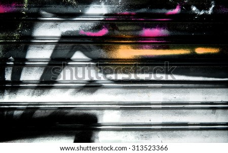 Abstract spray painting on metal door colorful wall background. Rustic and grunge texture urban. Many spray paint colors. Street and Fashion. Close up. - stock photo