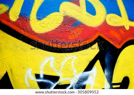 Abstract spray painting wall colorful background. Rustic and grunge texture urban. Many spray paint colors. Close up. - stock photo