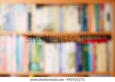 Abstract stack of hardback books on wooden table. Back to school. Copy space. - stock photo