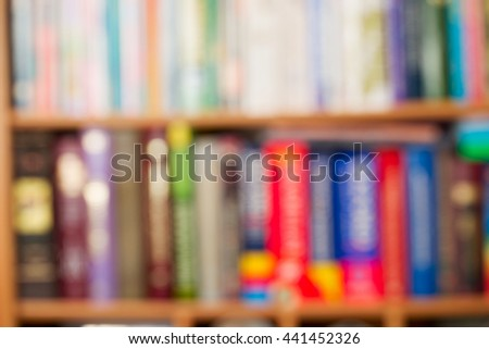 Abstract stack of hardback books on wooden table. Back to school. Copy space.
