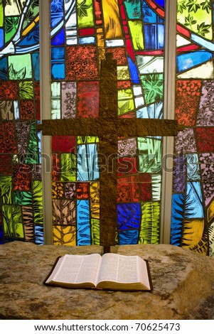 Abstract stained glass with iron cross and open bible - stock photo