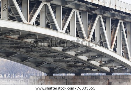 Abstract steel construction from under the bridge - stock photo