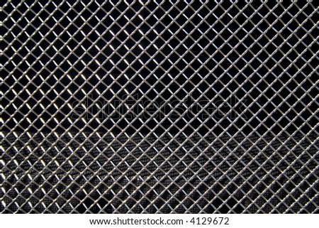 Abstract steel grid from car radiator. Black background - stock photo