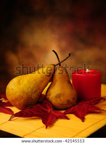 Abstract still life of a pair of pears under candle light in autumn - stock photo