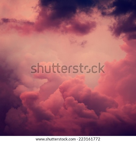 abstract storm clouds on sky at sunset time