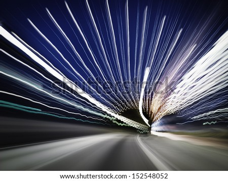 Abstract stripes from cars and lights in a traffic tunnel. - stock photo