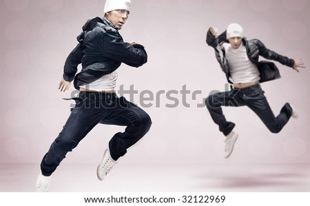 Abstract studio photo of two hip hop dancers - stock photo