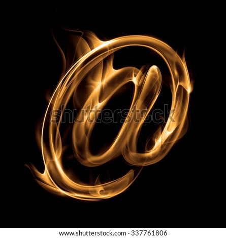 Abstract symbol burn AT.  Flame-simulated on black background.  - stock photo