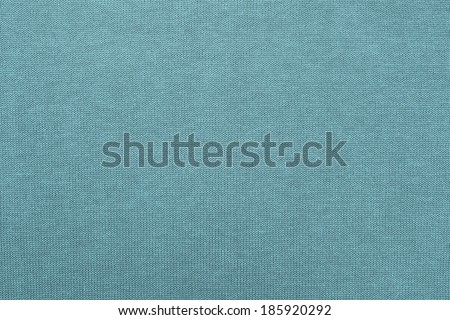 abstract texture of cotton fabric with synthetics for backgrounds and wallpaper of turquoise color closeup