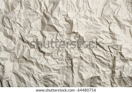 abstract texture of crumpled light brown recycled paper - stock photo