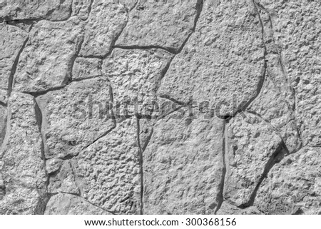 abstract texture of gray color of a stone wall with cracks for empty and pure backgrounds and for wallpaper