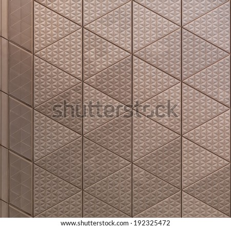 Abstract texture of metal architectural element with triangular pattern - stock photo