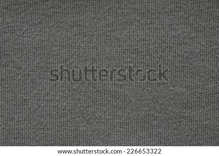 abstract texture of soft knitted fabric  with a pattern in the form of a herringbone for backgrounds of black color - stock photo