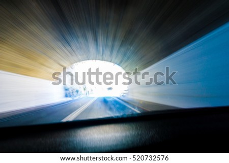 Abstract through car windscreen light at end of tunnel