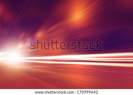 Abstract toned image of night lights in the city with motion blur. - stock photo