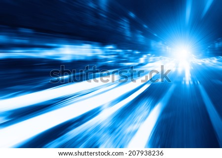 Abstract toned image of night lights in the city with motion blur.