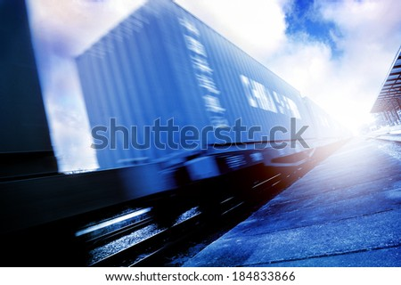 abstract train with container moving in cool tone - stock photo