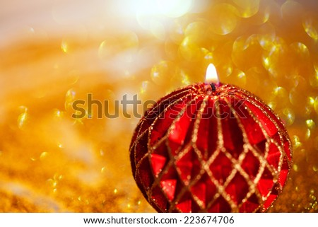 abstract  twinkled  christmas background with a candle