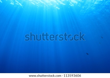 Abstract Underwater Blue Background with sunbeams - stock photo
