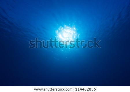 Abstract underwater blue with sunbeam - stock photo